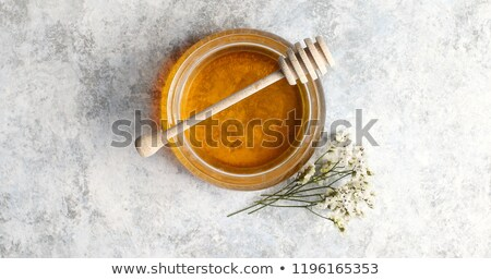 Bowl of honey with spindle Stock photo © dash