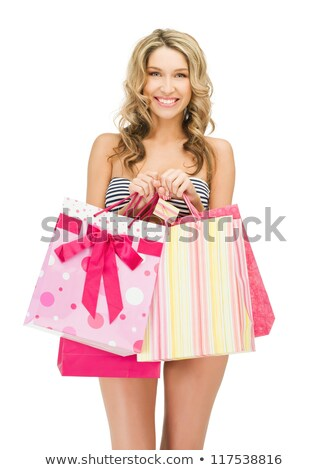Happy woman in swimwear holding shopping bags. Stock photo © deandrobot