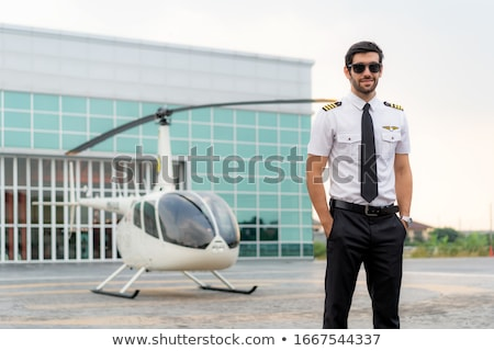 young man in small plane cockpit outdoors Stock photo © svetography
