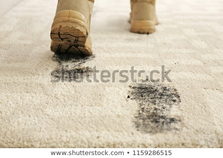 Person Walking With Muddy Footprint On Carpet Stock photo © AndreyPopov