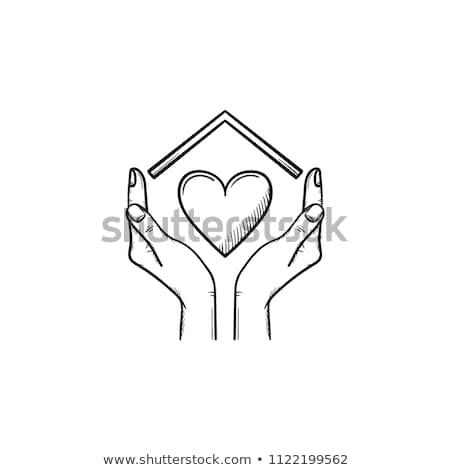 hand holding house hand drawn outline doodle icon stock photo © rastudio