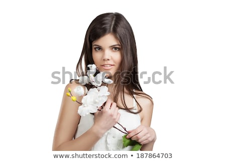 woman with orchid flower over green background stock photo © dolgachov