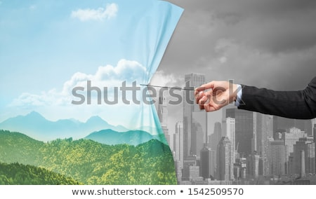 hand pulling green cityscape curtain to gray cityscape Stock photo © ra2studio