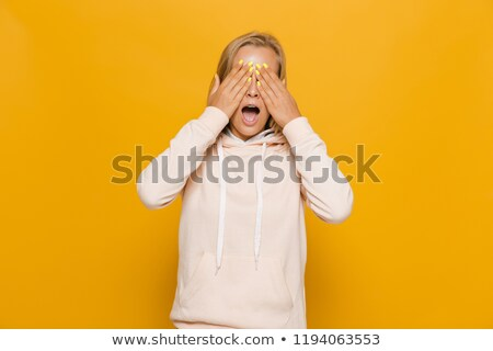 photo of scared young woman with dental braces covering eyes is stock photo © deandrobot