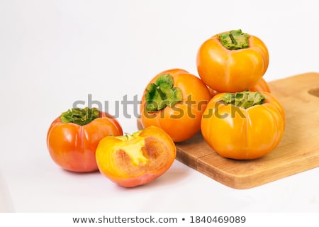 Fresh ripe persimmon on white cutting board Stock photo © furmanphoto