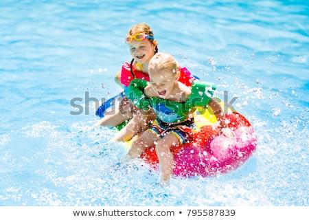 Girl and Boy Playing in a Pool Stock photo © 2tun