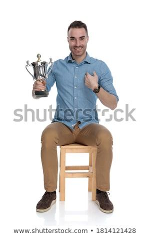 Dumny człowiek wskazując trofeum kubek Zdjęcia stock © feedough