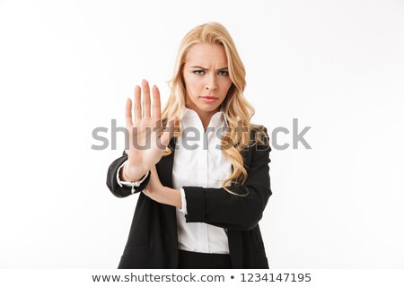 Photo of serious businesswoman wearing office suit showing palm  Stock photo © deandrobot