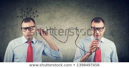 full of doubts business man with qirstions listening to self inner voice stock photo © ichiosea