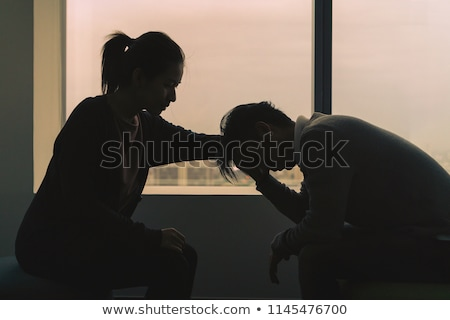 young psychologist talking with depressed couple stock photo © andreypopov