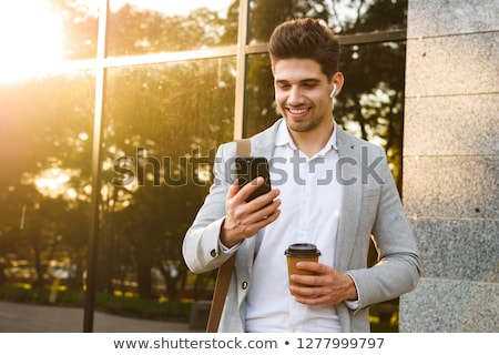 Fotoğraf ofis çalışanı takım elbise cep telefonu durmak Stok fotoğraf © deandrobot