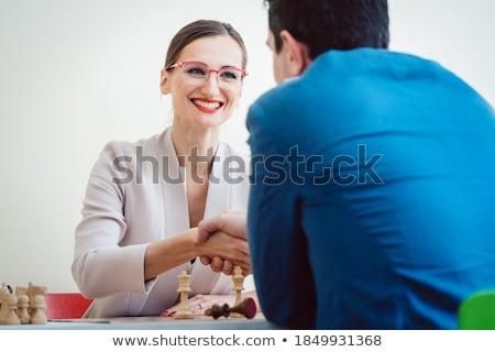 üzletasszony nyerő sakk jobb stratégia izgatott Stock fotó © Kzenon