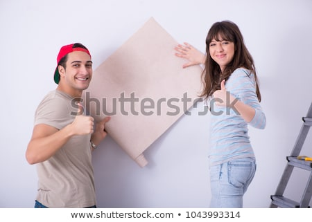 The young family doing renovation at home with new wallpaper Stock photo © Elnur