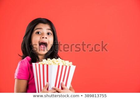 little girl wearing sunglasses and eating popcorn stock photo © dashapetrenko