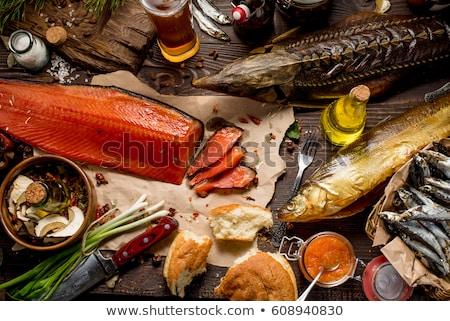 Stock photo: Smoked fish and beer on wooden background.