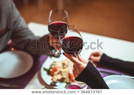 derűs · pár · étterem · szemüveg · vörösbor · lány - stock fotó © dolgachov