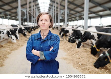 Young confident female farmer or worker of farmhouse crossing arms on chest Stock photo © pressmaster
