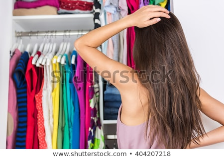 young woman chooses shirt in shop stock photo © galitskaya