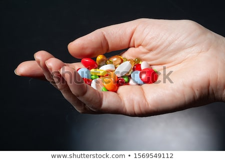 Drug Addicted Woman Reaching For Medication Stock photo © AndreyPopov