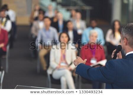 Vue arrière métis affaires micro parler Photo stock © wavebreak_media