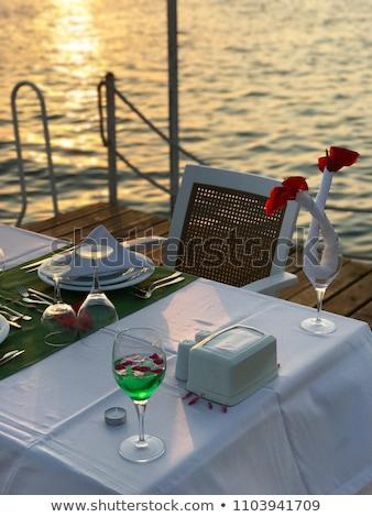 Lokanta deniz gün batımı su gıda manzara Stok fotoğraf © zurijeta