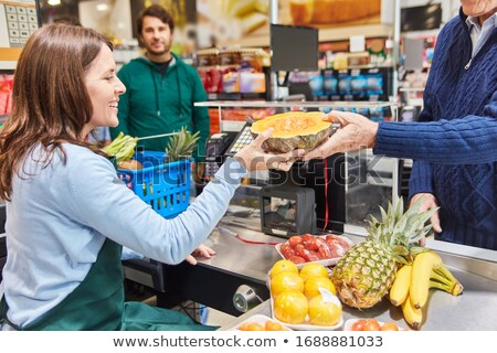 Man Pays Seller at Checkout for Products in Shop Stock photo © robuart