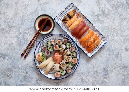 Asian food assortment. Various sushi rolls placed on ceramic plates Stock photo © dash