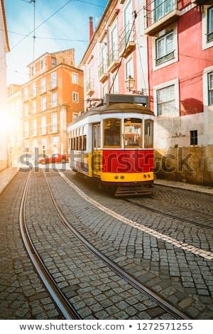 Villamos keskeny utca Lisszabon citromsárga kerület Stock fotó © neirfy