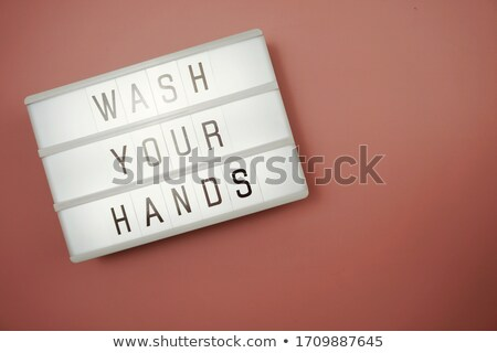 Phrase design for wash your hands in pink Stock photo © bluering