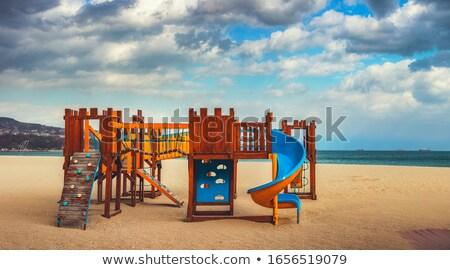 Speeltuin zonsondergang lege swing park gras Stockfoto © sahua