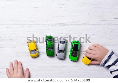 желтый автомобилей рук белый фон игрушку Сток-фото © alexandre17