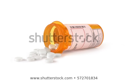 Yellow Medicine Bottle Spilling Pills Stock photo © iofoto