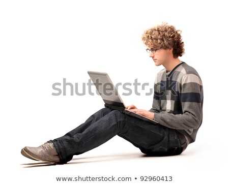 young boy with computer isolated on white  stock photo © dacasdo