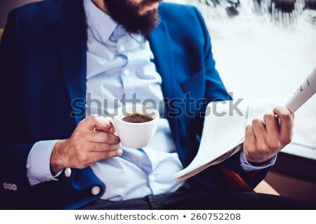 closeup portrait of young man with newspaper stock photo © hasloo