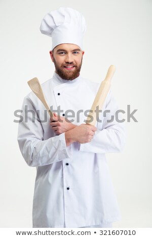 Male chef holding mixing spoon Stock photo © imarin