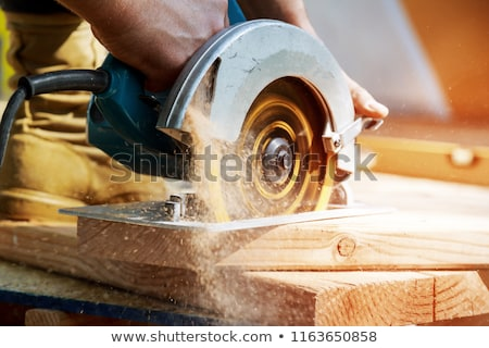 man using circular saw to cut wood stock photo © photography33