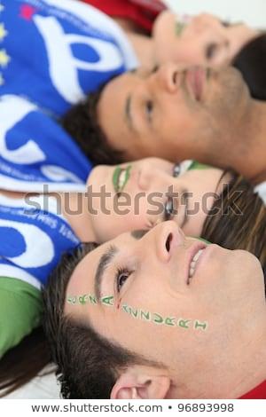 Italian football fans with Forza Azzurri facepaint Stock photo © photography33