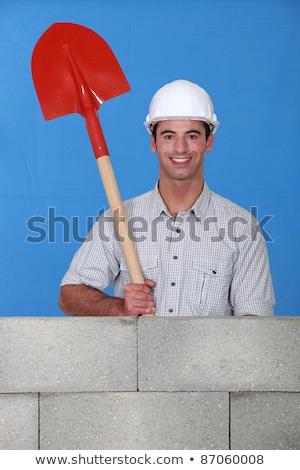 Man holding spade behind wall Stock photo © photography33