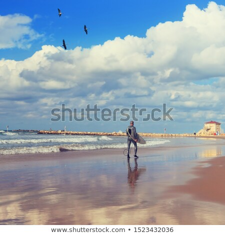Man walking along the quay on a sunny day Stock photo © photography33