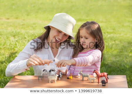little girl with animal figurines Stock photo © photography33