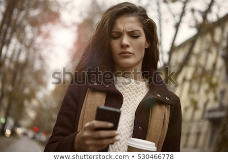 angry woman reading a text message stock photo © photography33