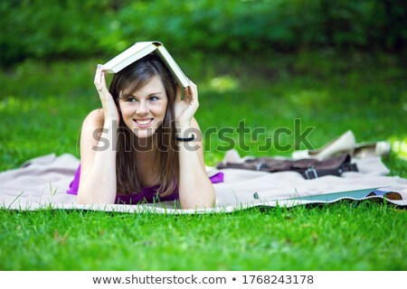 gorgeous young brunette outdoors with her book stock photo © lithian