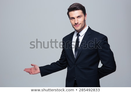 Smiling Business Man Gesturing with Open Hand  Stock photo © scheriton
