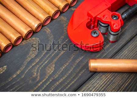 Plumber measuring copper pipe Stock photo © photography33