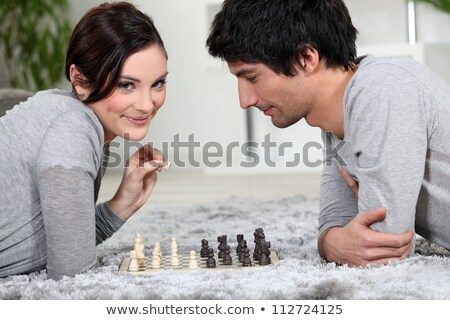 Couple playing chess whilst lying on the carpet Stock photo © photography33