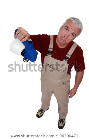 craftsman holding an empty sprayer and looking disappointed Stock photo © photography33