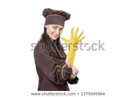 Smiling woman in apron pulling on rubber glove Stock photo © wavebreak_media