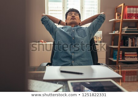 Architect reclining in his chair Stock photo © photography33
