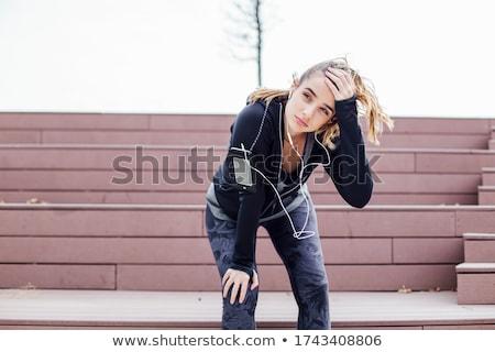 Güzel genç kadın kulaklık kırmızı kadın eğlence Stok fotoğraf © studio1901