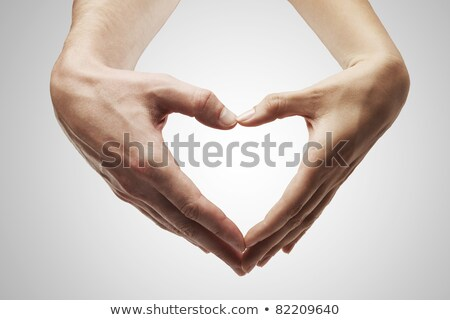 Twee handen geslacht borden gebouw hart Stockfoto © Nelosa